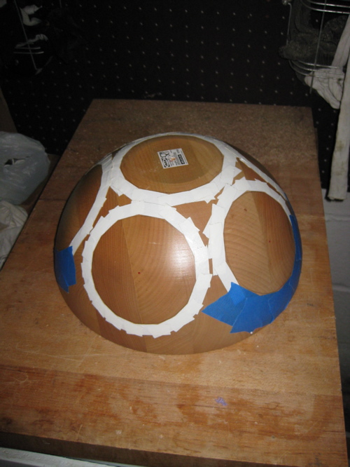 Salad bowl with speaker holes marked and taped