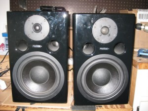 Here are the speakers on my workbench with a new tweeter installed on the left and the old one on the right.